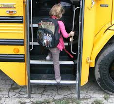 Girl entering school bus