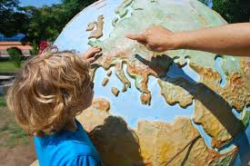 Child looking at world globe