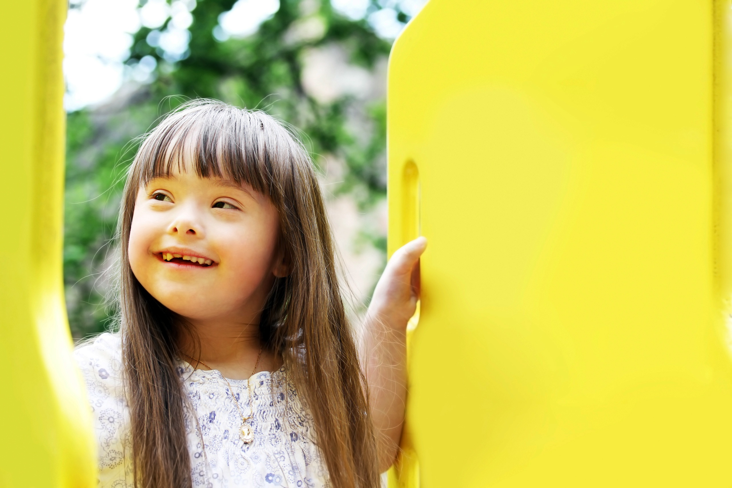 Downs syndrome girl on playground