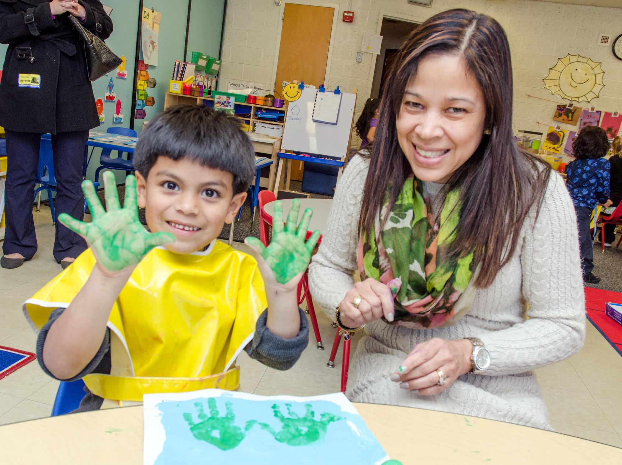 Child Hand Painting In Classroom